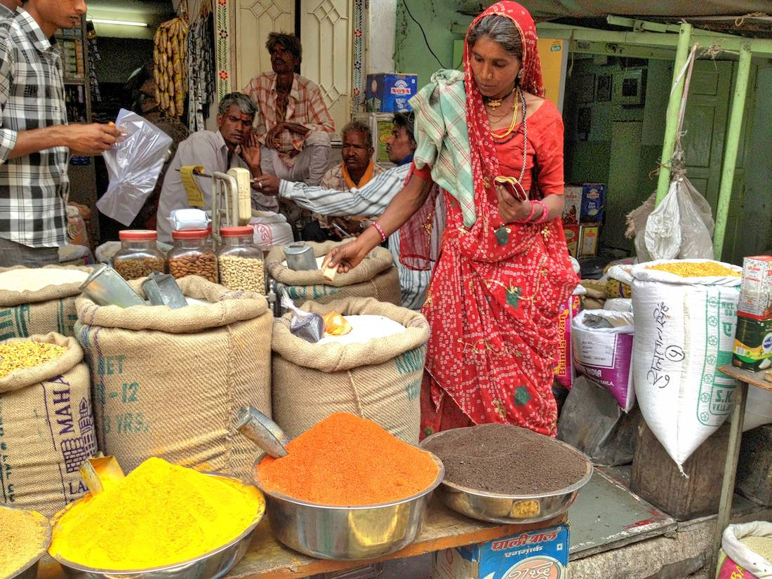 Woman buying spices Udaipur market
