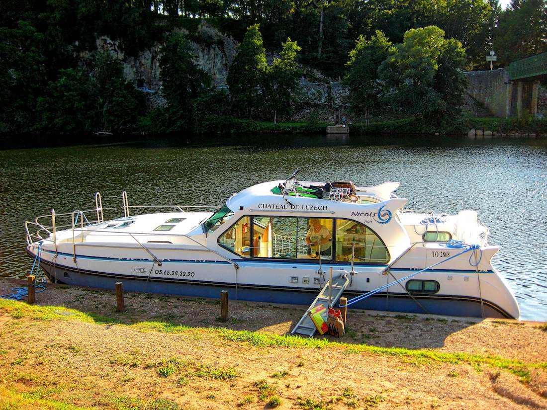 Peniche docked on the river bank